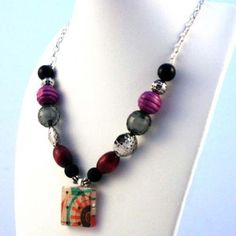 Very fun necklace from scabble tile and beads!