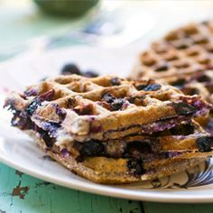 A crispy waffle, bursting with blueberries!