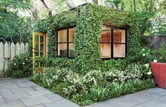"""Referred to by the designers as a """"green cube,"""" the small building seems to itself be alive. The ivy that grows on all of the exterior walls gives way only for the windows and roof. As the plants continue to grow and spread, the building will change and mature, allowing for a perpetually-changing outdoor sanctuary. Read more: http://dornob.com/lush-ivy-covered-building-is-a-living-backyard-home-office/#ixzz2WnCdxdRL"""