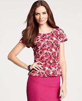 Blossom Top - Intoxicating florals flourish throughout this go-to peplum waist style for a perfectly new pretty. Jewel neck. Short sleeves.