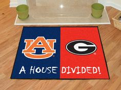 NCAA Officially licensed House Divided: Auburn / Georgia House Divided Mat Show everyone that your house is divided by die-hard fans of these two Auburn Vs Georgia, Rugs And Mats, Nylon Carpet, House Divided, Time Shop, Georgia Bulldogs, Large Rugs, Floor Rugs, Divider