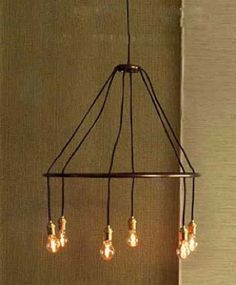Roost Halo Chandelier: $300  Inspired by the austere designs of turn-of-the-century light fixtures, Roost has created this suspended halo lamp of antique-finished solid brass and cloth-covered cords. This simple and timeless embodiment employs the light itself as its only ornamentation. Bulbs not included. Sockets have 60 watt max. Hardwire only.