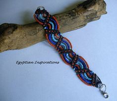 Micro macrame bracelet in coral pink, blue and turquoise. Micro macrame jewelry.