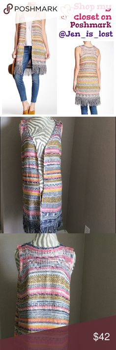 """Fringe Print Vest Small Fringe Print Vest A sleeveless open front topper features bright multi-color knit construction with fringe trim at the hem. - Open front - Sleeveless - Approx. 37"""" length Fiber Content: 90% acrylic, 10% polyester Tops"""