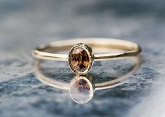 Oval red zircon ring handcrafted in 14k yellow gold red by ARPELC