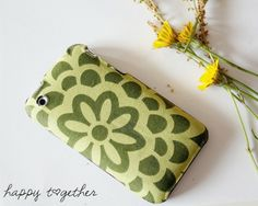Make an old cell phone cover into a new one with some fabric and mod podge!