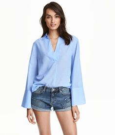 Experiment with trend-forward tops that are still sophisticated, like this blouse with exaggerated sleeves.H&M Wide Sleeve Cotton Blouse, $29.99, available at H&M. #refinery29 http://www.refinery29.com/business-casual-for-women#slide-9