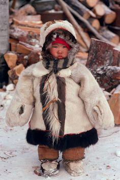 **Small Chukchi child in traditional fur clothing. Chukotka, Siberia.Russia: Russia, Chukotka: