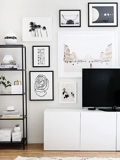 There's visual power in the pairing of large and small scale art. Extra-large 40-inch framed pieces can sit nicely alongside tiny 8-by-10-inch pieces. To ensure balance, just make sure to limit both your color palette and frame styles.