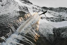 A Cougar helicopter of the Swiss Air Force releases flares during a flight demonstration of the Swiss Air Force over Axalp in the Bernese Oberland 10/11/12