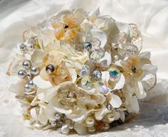Went on EBAY and brought a whole heap of crystal brooches (cheap as) for us to see what creating 'crystal boquet' looks like- or maybe a mix of bling and real flowers? (peonies and roses me likes)