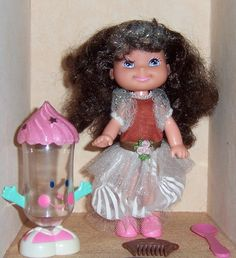 Cherry Merry Muffin Dolls. My sister had a few of these. This one in particular smelled like chocolate and she had sparkly streaks in her hair. I loved playing with it.