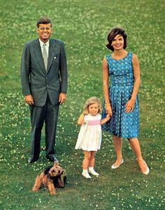 The John F. Kennedy family: JFK, Caroline and Jacqueline with dog Charlie (Welsh Terrier). Charlie often attended the oval office with President Kennedy.