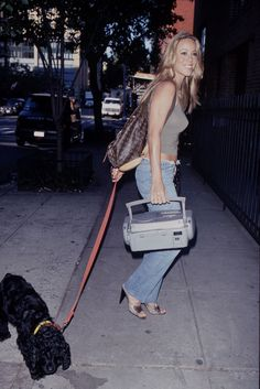 12 '90s Mariah Outfits That Prove She Has Range #refinery29  http://www.refinery29.com/mariah-carey-lookbook-throwback-90s-fashion#slide-9  The Louis Vuitton backpack, her little puppy, Jack, the bootcuts, the slingbacks, and the boom box. Marry us, Mariah? ...