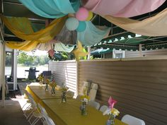 Elephant & Pinwheels First Birthday Party - $1 Dollar Store tablecloths ceiling decoration with balloons and pinwheels. DIY. Budget friendly.