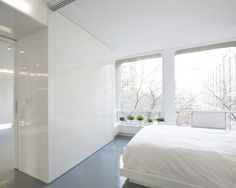 Minimalist All White Modern Bedroom- walls made into built-in storage- by Dash Marshall, Remodelista