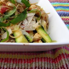 Angel hair pasta with chicken, zucchini, and tomatoes.