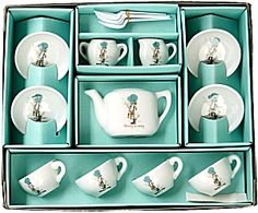 Holly Hobbie Tea Set.  This is like my 1st one as a kid.  Sadly,  I chipped the tea pot..so I bought another one one when I become an adult.