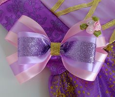 Rapunzel Inspired Hair Bow, Purple Hair Bow, Rapunzel Bow by nemehairbows on Etsy https://www.etsy.com/listing/462139472/rapunzel-inspired-hair-bow-purple-hair