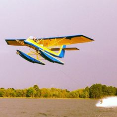 Keith St.Onge barefoot water skis behind a plane!!