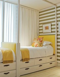 twin beds in small space with drawer storage under