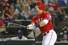 Texas' Jake Smolinski watches the flight of his fourth-inning solo homer during the Oakland Athletics vs. the Texas Rangers major league baseball game at Globe Life Park in Arlington on Saturday, September 27, 2014. (Louis DeLuca/The Dallas Morning News)