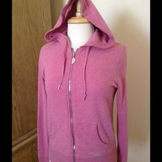 Victoria's  Secret Super Model Essentials Hoodie Pink hoodie with rhinestone wings design in the back. Some small stones are missing ( fourth pic)  but are not that noticeable unless you look closely.                     60% Cotton 40% Polyester Victoria's Secret Tops Sweatshirts & Hoodies