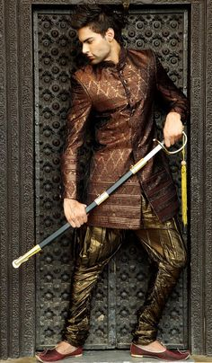 One of the majorly worn Wedding Sherwani nowadays is Jodhpuri Sherwani. Jodhpuri Sherwani is not only limited to Jodhpur but its famous all over the world. Mens Sherwani, Wedding Sherwani, King Fashion, Men's Fashion, Bollywood Outfits, Baggy Trousers, Indian Men Fashion, Ethnic Dress, Jodhpur