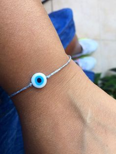 Excited to share this item from my #etsy shop: Silver evil eye bracelet Silver string bracelet Minimalist bracelet Adjustable bracelet Evil eye jewelry Protection bracelet Greek evil eye #gold #birthday #christmas #evileye #yes #unisexadults #glass #tie #minimalist Evil Eye Jewelry, Evil Eye Bracelet, Bracelets For Men, Silver Bracelets, Jewelry Gifts, Handmade Jewelry, Greek Evil Eye, Gold Birthday, Adjustable Bracelet