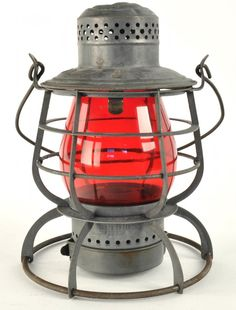 Armspear Man'fg Co. New York, tall globe lantern with double horizontal guards, one plate and one wire for the Chesapeake & Ohio Railway with red globe.