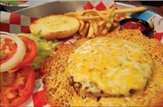 CJ's Sports Bar and Grill: Our classic Big Cheese Burger!  Can you handle this?  Only served at Mel's Lone Star Lanes in Georgetown, TX.  Fixin's on the side, served with French Fries.
