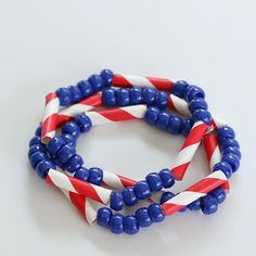Kids of all ages can make these American flag inspired necklaces and bracelets to wear to all kinds of patriotic celebrations!