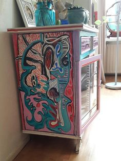 My grandma's cabinet, decorated with markers and acrylic paint...sorry oma❤