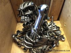Piston Head Army Continues To Impress - BlackSheepWarrior. Welding Art Projects, Metal Projects, Metal Crafts, Welding Ideas, Steel Art, Steel Metal, Metal Sculpture Wall Art, Scrap Metal Art, Old Tools