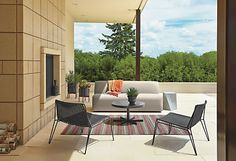The Laguna outdoor sofa lends modern comfort to any outdoor space.
