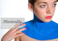 Beautiful young woman with décolleté painted with electric blue ...