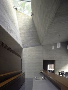 Here's a second project in China by David Chipperfield Architects: Ninetree Village is a recently completed residential development in Hangzhou. The project is situated next to a bamboo forest and consists of twelve residential buildings, each containing five apartments. Each building is clad in a wooden grid, which varies in density according to the level