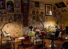 This is a Beautiful tattoo shop. I would like to design a wall in my house some day like a wall in a tattoo shop.