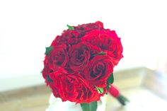 Garden Picked.Made with all preserved red roses this bouquet will last long beyond the wedding day. Red garden roses and deeper red standard roses preserved perfectly. Stems wrapped with red velvet ribbon.