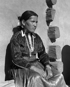 Navajo woman wearing a long, fluted skirt and a velveteen blouse reflecting the Spanish influence (1955). Adorning her blouse are Winged Liberty Head dimes also known as Mercury dimes. Minted between 1916 and 1945, each dime weighs 2.5 grams and is 90% silver and 10% copper. Its designer, Adolph A. Weinman, intended the wings surrounding her cap to symbolize liberty of thought.