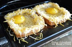 putting cheesy baked egg toast in toaster
