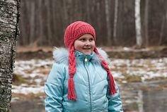 This hat with braids is knitted back and forth in rows. You only need 2 needles to knit it.