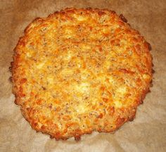 Coconut Flax Cheesy Pizza Crust: 1 cup Mozzarella Cheese, shredded 1 Egg 1 Tbsp Coconut Flour 1 Tbsp Flax Meal (grind flax seeds in coffee grinder or vitamix) 1/4 tsp Baking Powder 1/8 tsp Garlic Powder 1/8 tsp Basil Preheat oven to 350*. If you have a baking stone, put it in the oven to preheat as well.