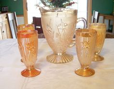 """Iris & Herringbone Marigold footed pitcher and tumblers. Iris pattern by Jeannette Glass, reissued in the 1950's in the """"marigold"""" iridescent. (The earlier pattern in crystal was reproduced by other companies.)"""