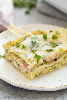 This White Chicken Lasagna with Ham and Spinach is the ULTIMATE comfort food! Made with a lighter Alfredo sauce, it's decadent but made easier and healthier
