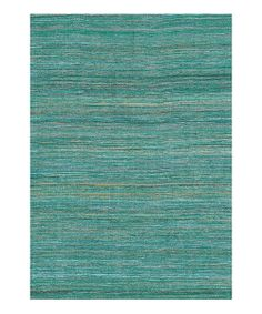 Simple and stylish. One of the best things about this fashionable rug is that it works in any room in the house. The jacquard-woven blend adds a splash of color and is a silky treat for feet.Available in multiple sizesRug thickness: 0.25''PolyesterImported
