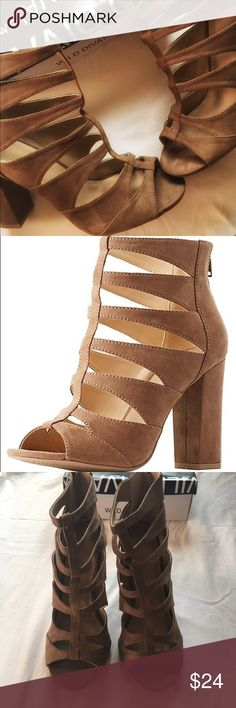 👠Charlotte Russe Faux Suede Caged Sandals👠 Brand new on trend faux suede caged sandals in a taupe color purchased from Charlotte Russe. These stylish shoes have a sleek strap in front to divide the cut-outs along the way. Shoes also have a covered block heel, peep toe silhouette, and zipper closure at back. Insoles are lightly cushioned and soles feature a non-skid rubber. Sandals did come with slight imperfection to left insole (pictured).  Brand: Wild Diva Lounge Product Fit: Shaft…