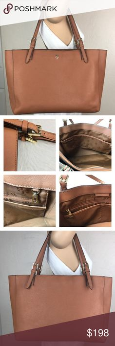 Tory Butch large York buckle Brown Tote This bag is great for traveling, luggage or trips thru town. A zip up pouch in center for tablet or a full laptop. 4 Open pouches, a place to hang keys and 1 zipper pouch. This bag is lovely, there is a small scuff on bottom of bag but other then that it is in excellent condition. Take this bag with you on your next trip!!! Tory Burch Bags Travel Bags