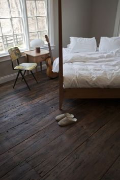 love the worn floors against the clean white sheets and windows