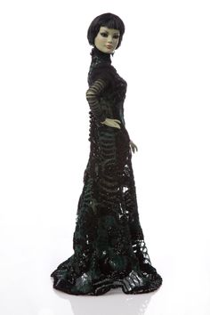 The Wizard of oz The Wicked Witch of The West Tonner Doll by Marc Jacobs | eBay  #TheWickedWitch by #MarcJacobs for #WizardOfOz75 collection #TNPLH #HabitatForHumanity // #nyfw New York Fashion Week 2014 charity auction / fashion sketch / designer / collectible / Tonner Doll / turtleneck / long sheer sleeves / lace dress / short bob / short straight bangs / black and green